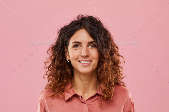 Young woman with curly hair - Stock Photo - Images