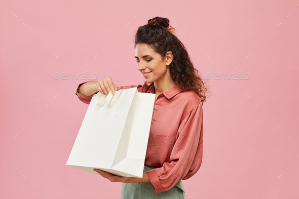 Woman looking at her purchases - Stock Photo - Images