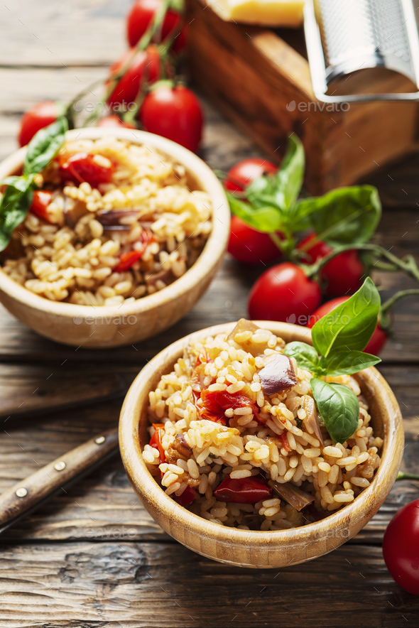 Vegetaian rice with onion, tomato and eggplant - Stock Photo - Images