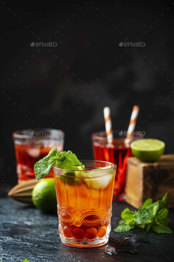 Red fresh cocktail with ice and lime - Stock Photo - Images