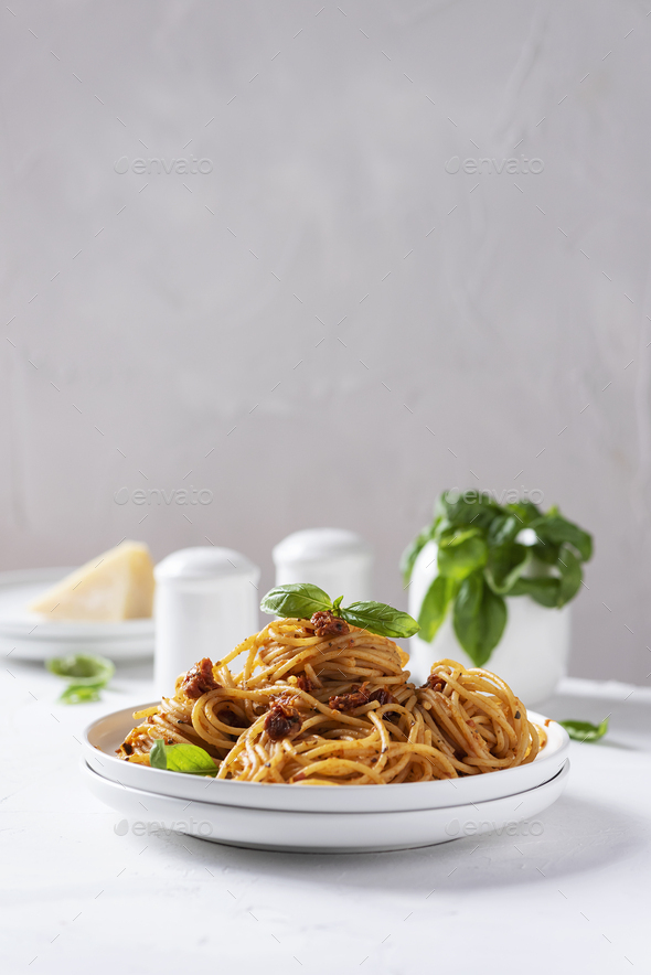 Italian pasta with dried tomatoes - Stock Photo - Images