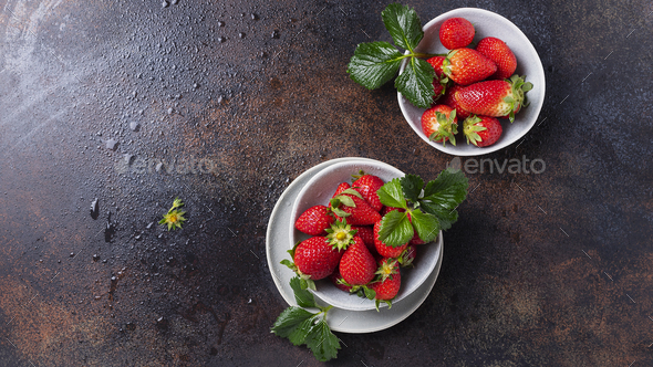 Fresh strawberry with a green leaves - Stock Photo - Images