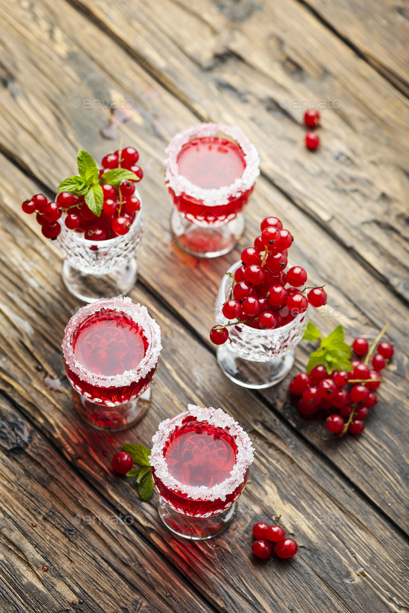 Red currant liquor with sugar and mint - Stock Photo - Images