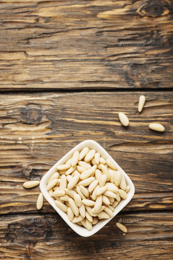 pine nut on the wooden table - Stock Photo - Images
