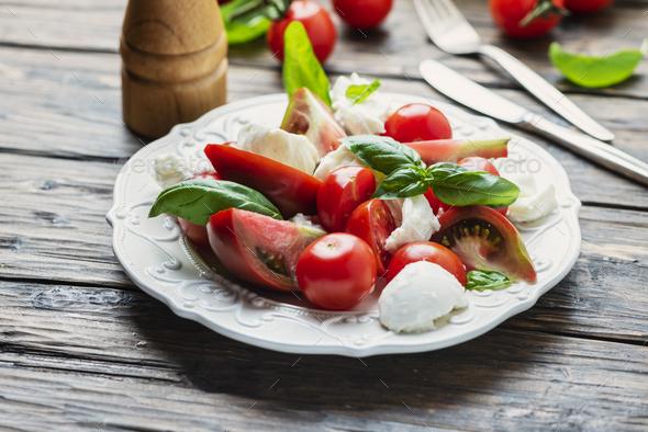 Italia salad caprese with tomato, basil and mozzarella - Stock Photo - Images