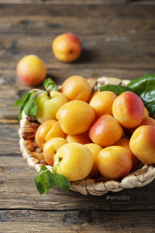 Sweet apricots on the wooden table - Stock Photo - Images