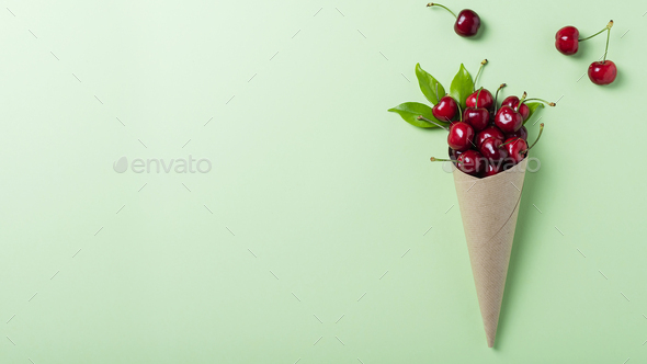 Sweet fresh cherry into paper cone - Stock Photo - Images
