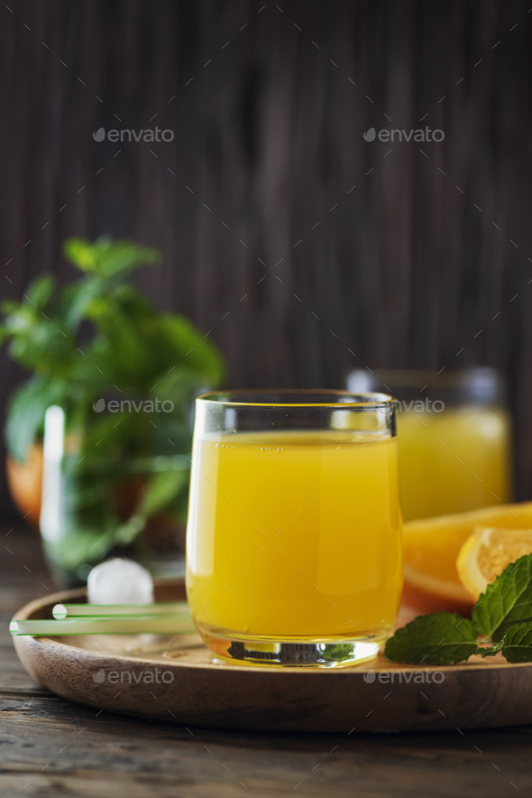 Orange cocktail on the wooden table - Stock Photo - Images