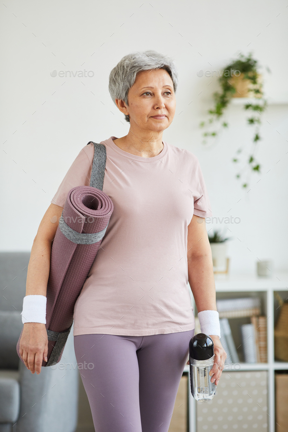 Senior woman doing sports at home - Stock Photo - Images