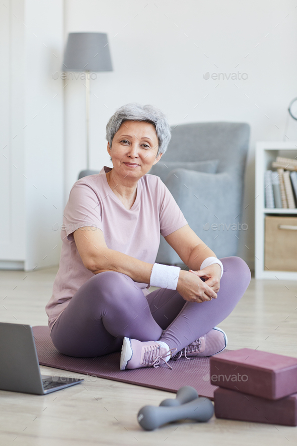 Senior woman training at home - Stock Photo - Images