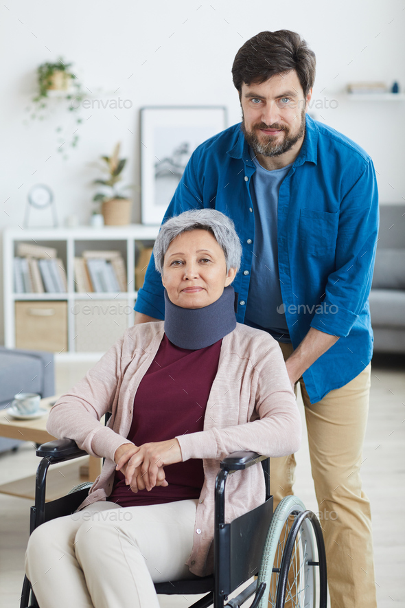 Man caring about disabled woman - Stock Photo - Images