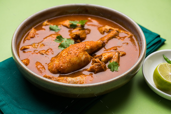 Indian Reddish Chicken Curry - Stock Photo - Images