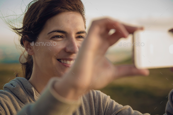 Woman taking a picture - Stock Photo - Images