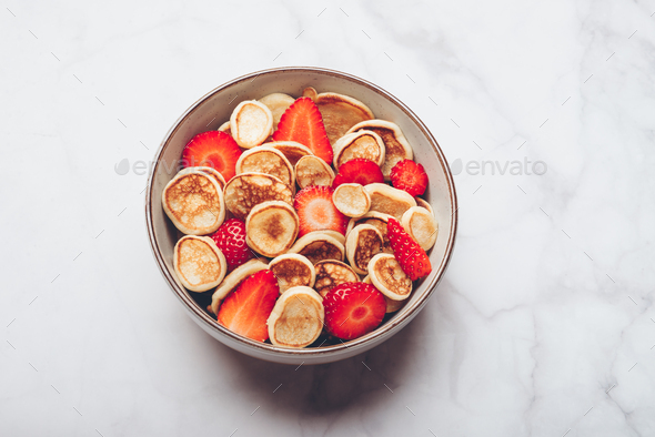 Tiny cereal pancakes and strawberries - Stock Photo - Images