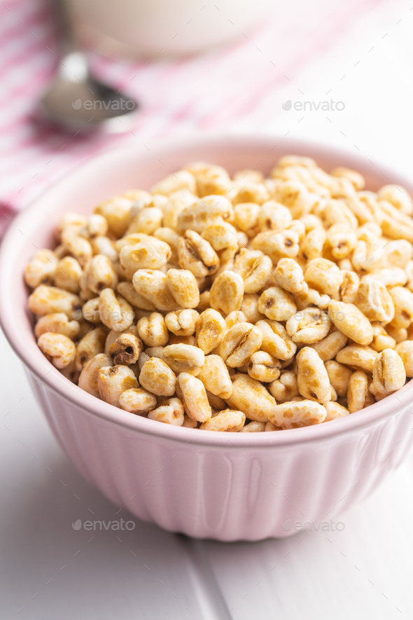 Puffed wheat covered with honey in bowl. - Stock Photo - Images
