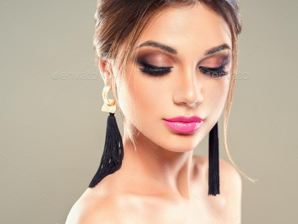 Beauty brunette woman makeup earrings beautiful hairstyle beauty lips lashes eyes model portrait - Stock Photo - Images