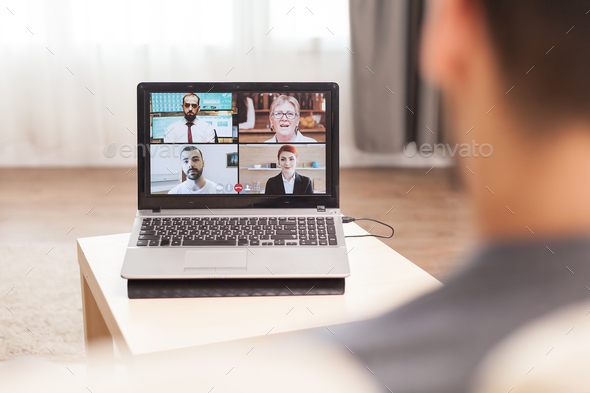 Businessman in a video conference - Stock Photo - Images