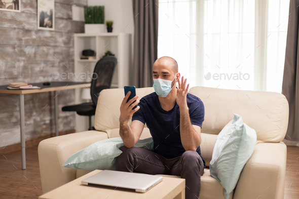 Guy waving during video call - Stock Photo - Images