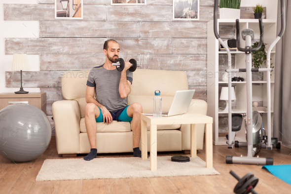 Man in sportswear holding dumbbells - Stock Photo - Images