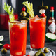 Bloody Mary Cocktail in glasses with garnishes. - PhotoDune Item for Sale