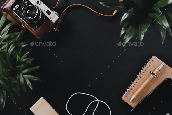 Top view of a flat lay film camera in case notepad - Stock Photo - Images