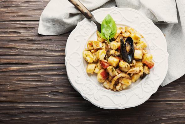 Italian potato gnocchi with seafood - Stock Photo - Images