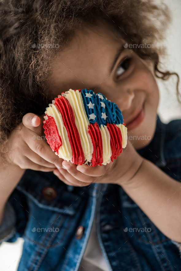 Cute African American Baby Girl With American Flag Muffin - Stock Photo - Images