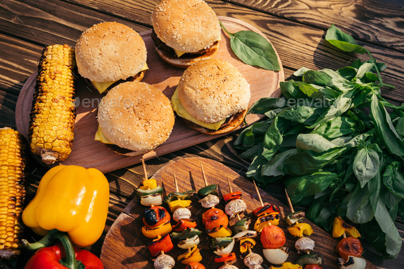 Hot Delicious Burgers And Vegetables Cooked Outdoors on Grill - Stock Photo - Images