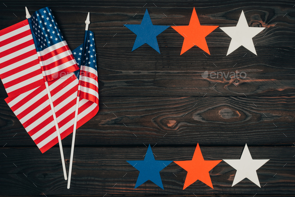 Top View of Arranged American Flags And Stars on Wooden Surface, Presidents Day Celebration Concept - Stock Photo - Images