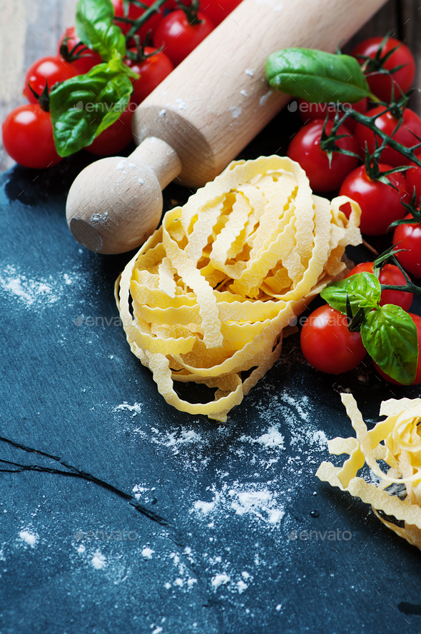 Uncooked italian pasta on the table - Stock Photo - Images