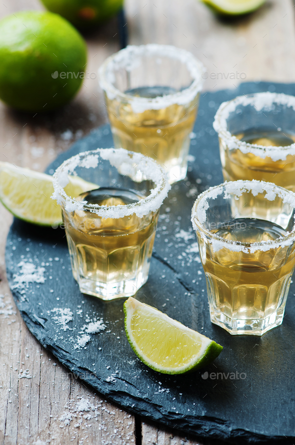 Gold tequila with lime and salt - Stock Photo - Images