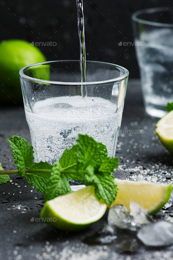 Mojito cocktail in a bur on a rustic table - Stock Photo - Images