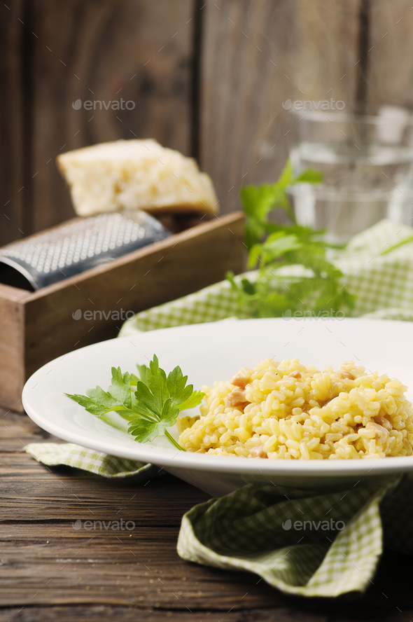 Italian traditional risotto with saffron and ham - Stock Photo - Images