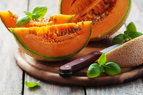 Sweet fresh melon on the wooden table - Stock Photo - Images