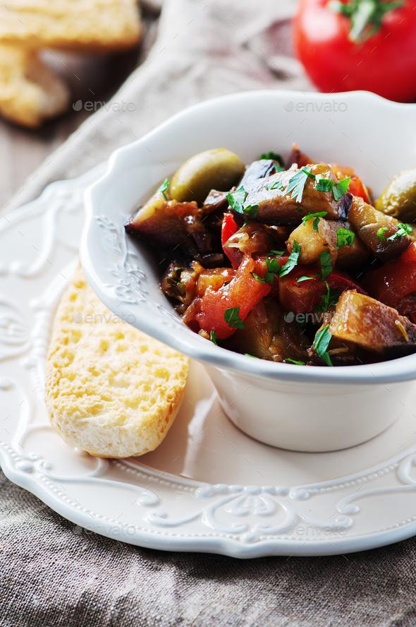 Traditional sicilian dish caponata with eggplant and tomato - Stock Photo - Images