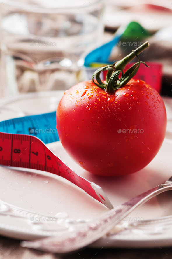 Concept of diet with red tomato and water - Stock Photo - Images