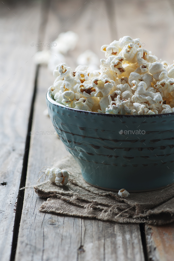 Popcorn and cola on the wooden table - Stock Photo - Images