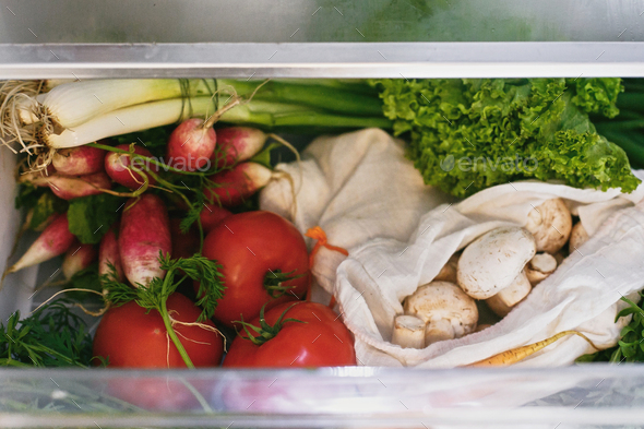 Zero waste grocery in fridge. Fresh vegetables in opened drawer in refrigerator - Stock Photo - Images