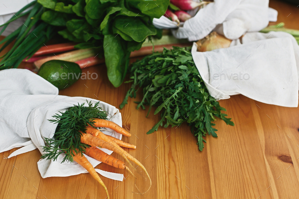 Zero waste grocery shopping concept. Reusable eco friendly bags with fresh vegetables - Stock Photo - Images