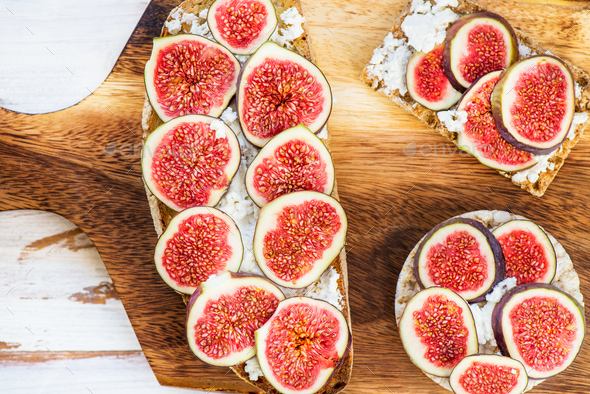 Healthy crackers and toast with figs and ricotta cheese - Stock Photo - Images