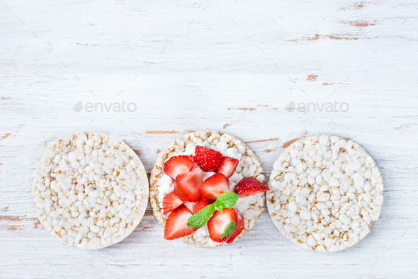 Healthy Snack from Rice Cakes with Ricotta and Strawberries - Stock Photo - Images