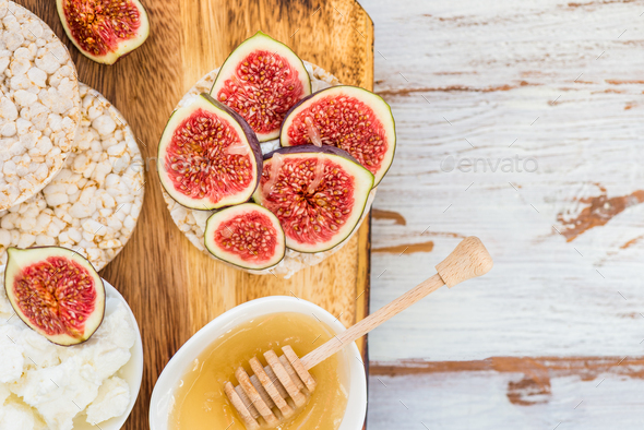 Healthy snack from Rice cakes, figs and ricotta cheese - Stock Photo - Images