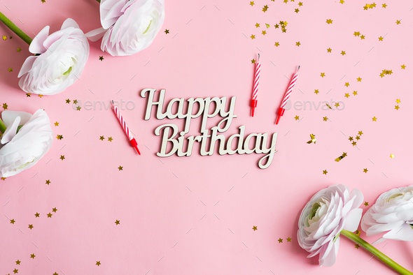 Festive backdrop from bright stars decoration, candles for cake and text Happy Birthday , ranunculus - Stock Photo - Images