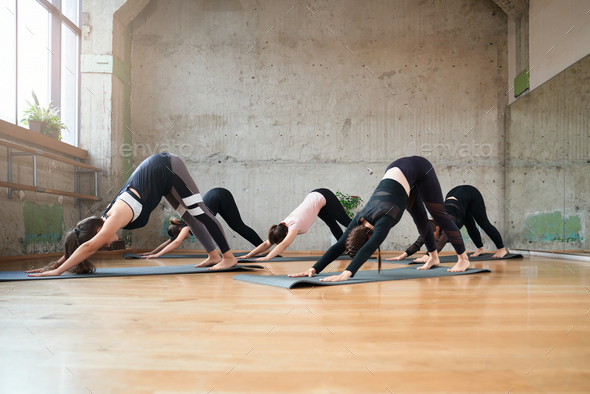 Group of women practicing in hall - Stock Photo - Images