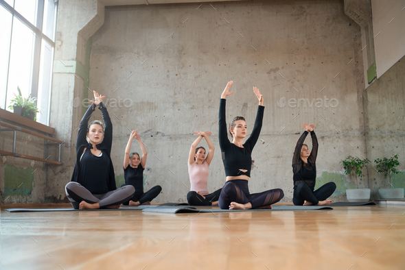 Group Of Women Sitting In Lotus Pose In Hall Stock Photo By Serhiibobyk The best gifs are on giphy. photodune