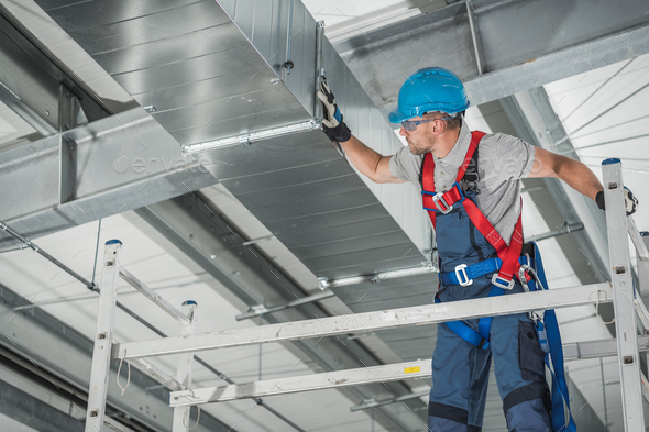Professional Technician Worker Finishing Newly Assembled Air Vent Shaft - Stock Photo - Images