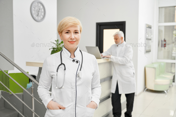 Female doctor keeping hands in pockets - Stock Photo - Images