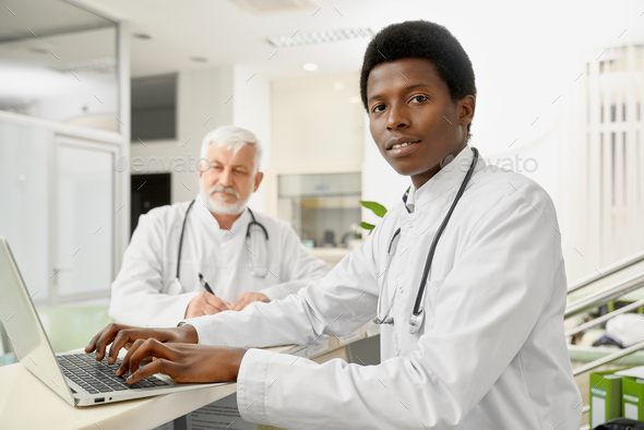 Multicultural doctors on reception - Stock Photo - Images