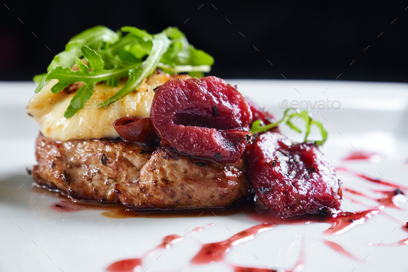 Beef served with plums, mozzarella and rucola - Stock Photo - Images