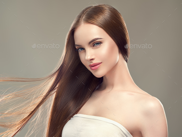 Beautiful hair smooth long brunette beauty woman healthy hairstyle young happy female model - Stock Photo - Images